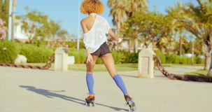 Sexy Back of Riding Girl on Roller Skates stock video footage