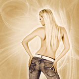 back of a woman wearing jeans Stock Photos