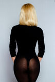 Sexy back of young beautiful blonde in lingerie over dark background Royalty Free Stock Image