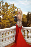 Sexy back young beauty woman in mermaid red dress. gorgeous fash Stock Image