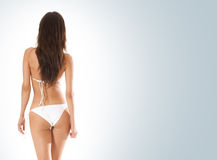 Sexy back of a young brunette in white bikini Stock Photo