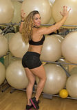 With Balls. Israeli fitness model and trainer, Dana Shemesh, strikes a in Ramat Gan, Israel. The sultry sabra athletic beauty has won the title of Ms Fitness royalty free stock photos