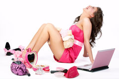 Barbie girl in pink. Woman laughing in pink dress and pink stuff around stock photos