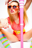 Sexy baseball girl wearing colorful clothes posing Stock Photography