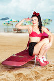 Sexy beach pin up girl wearing high heels Royalty Free Stock Image