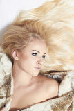 Sexy Beautiful blond woman in fur coat.winter style.young pretty girl. Beauty Model Girl in Mink Fur Coat Royalty Free Stock Photos