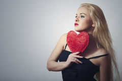 Sexy Beautiful Blond Woman with Red Heart. Beauty Girl. Show Love Symbol. Valentine's Day.Passion Royalty Free Stock Photos