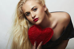 Sexy Beautiful Blond Woman with Red Heart. Beauty Girl. Show Love Symbol. Valentine's Day.Passion Royalty Free Stock Photography
