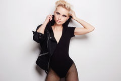 Sexy beautiful blond woman with short hair. Fashion beauty punk girl dresses hood Royalty Free Stock Photography