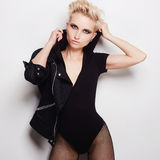 Sexy beautiful blond woman with short hair. Fashion beauty punk girl dresses hood Stock Image