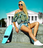 Sexy beautiful blonde model with skateboard Royalty Free Stock Photo
