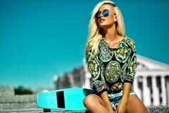 beautiful blonde model with skateboard Stock Photo
