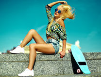 beautiful blonde model with skateboard Royalty Free Stock Images