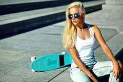 Sexy beautiful blonde model with skateboard Stock Photos