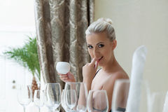 Sexy beautiful blonde posing in restaurant Royalty Free Stock Photos