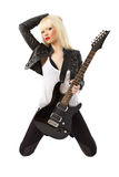 beautiful blonde woman in posing with guitar Royalty Free Stock Image