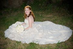 Sexy beautiful bride in white dress sitting Royalty Free Stock Photos