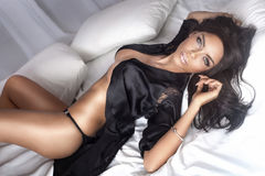 Sexy beautiful brunette lady lying. Royalty Free Stock Images