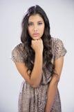 Sexy beautiful brunette looking at camera touching chin Royalty Free Stock Photo