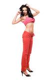 Sexy beautiful brunette in a red jeans Royalty Free Stock Photo