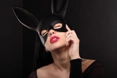Sexy, beautiful, charming, woamn in black rabbit mask and elegant dress. Royalty Free Stock Photography