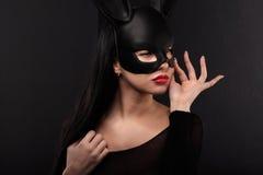 Sexy, beautiful, charming, woamn in black rabbit mask and elegant dress. Stock Photography