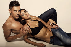 Sexy beautiful couple in jeans Royalty Free Stock Photos