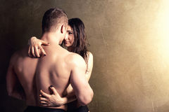Sexy beautiful couple. Sexy couple posing in  studio. Handsome muscular men with girlfriend Stock Images