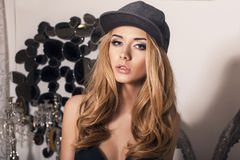 sexy beautiful girl with blond hair in cap Stock Photo