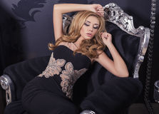 Sexy beautiful girl with blond hair in elegant dress Stock Photos