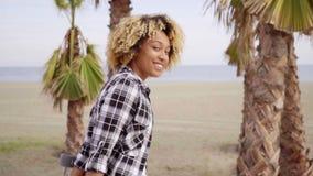 Sexy beautiful girl with longboard on the beach stock video footage