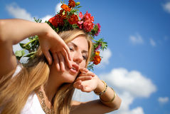 Sexy Beautiful Girl in marigold wreath with raised Royalty Free Stock Images