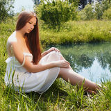 Sexy beautiful girl near the water Stock Photography