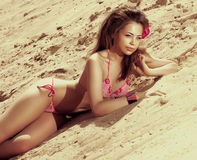 beautiful girl sunbathing on sandy beach Stock Photography