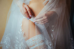 Sexy beautiful nude bride with veil in white erotic lingerie Royalty Free Stock Photo