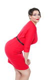 Sexy beautiful plus size woman in red dress posing Royalty Free Stock Images
