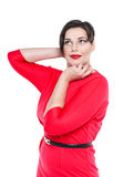 Sexy beautiful plus size woman in red dress posing isolated Royalty Free Stock Photography