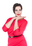 Sexy beautiful plus size woman in red dress posing isolated Royalty Free Stock Image