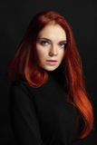 Sexy beautiful redhead girl with long hair. Perfect woman portrait on black background Gorgeous hair and deep eyes. Natural beauty Royalty Free Stock Images