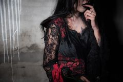 Sexy Beautiful Vampire hungry and finding for blood in abandoned house, Halloween Festival, Horror and Beauty fashion concept, royalty free stock photos