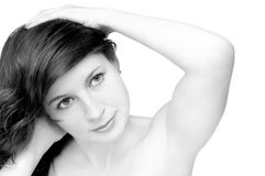 Sexy beautiful woman. The beautiful woman has put hands on a head,  a sensual sight, the mouth is slightly opened, on a white background, black-and-white, close Royalty Free Stock Images