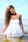 and beautiful woman on beach Royalty Free Stock Photos