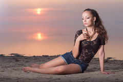 Sexy beautiful woman on the beach at sunset Royalty Free Stock Photos
