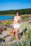 Sexy beautiful woman in bikini walking on the beach. Sexy beautiful woman in bikini with beer walking on the beach Stock Images