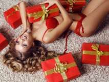 Sexy beautiful woman with blond curly hair in lingerie with presents Stock Photography