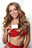 Sexy beautiful woman with blond curly hair in lingerie with visit card Stock Image