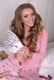 Sexy beautiful woman with blond curly hair in pajama with slippers Royalty Free Stock Photos