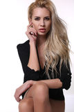 Sexy beautiful woman with blond hair in elegant jacket Royalty Free Stock Image