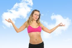 Sexy beautiful woman with blond hair and sport clothes doing lotus hands yoga pose in top bra Royalty Free Stock Photo