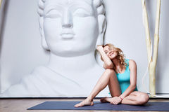 Sexy beautiful woman blond hair sporty body shape yoga, exercise Royalty Free Stock Photo